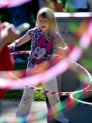 Allysa Earnst, 7, gives the hula hoop a whirl at 2014