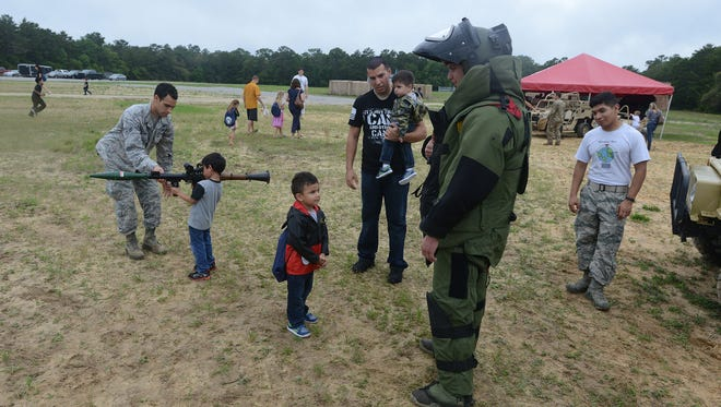Kids check out mock RPGs and a EOD suit Saturday at Eglin Air Force Base during Operation Hero, a mock deployment process for kids in recognition of the month of the military child.