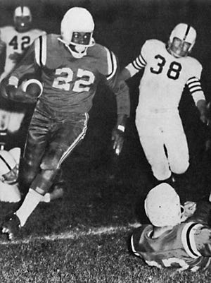 Marshall Starks runs for yardage during his senior year at Rockford West in 1956.