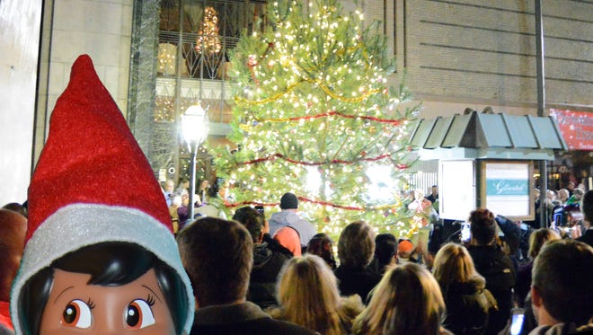 Saul S. Bury, the city of Salisbury's resident elf, sneaks around at the tree lighting on the Downtown Plaza.
