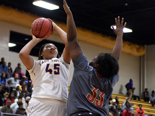 Hattiesburg High's Melyia Grayson shoots over a defender