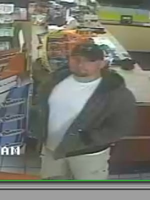 Surveillance image of suspect in theft at Tea exit truck stop.