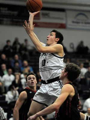 Providence's Eli Coker (10) shoots against Brownstown Central on Saturday at Providence High School. (Photo by David Lee Hartlage, Special to The Courier-Journal) Feb.18, 2017