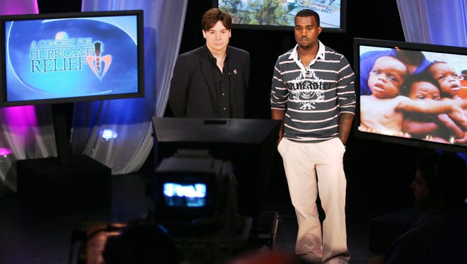 A concert for Hurricane relief (l-r) Mike Myers and Kanye West.