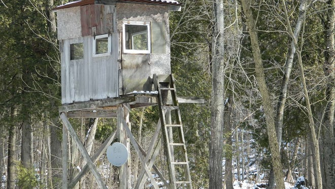 """I was out walking the trail and saw this deer stand with dish on it,'' writes Frank Kolczak."