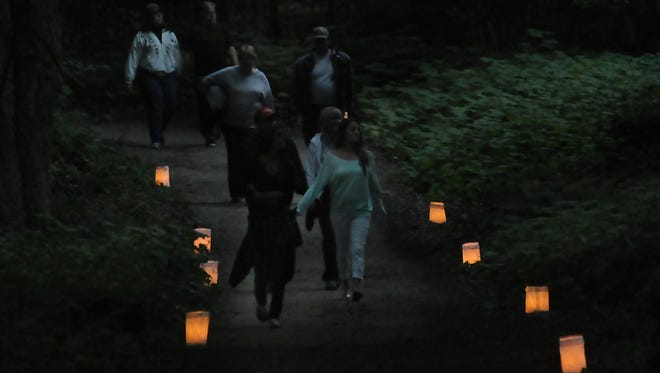 More than 1,000 walkers participated in a candlelight hike at Whitefish Dunes State Park east of Sturgeon Bay.