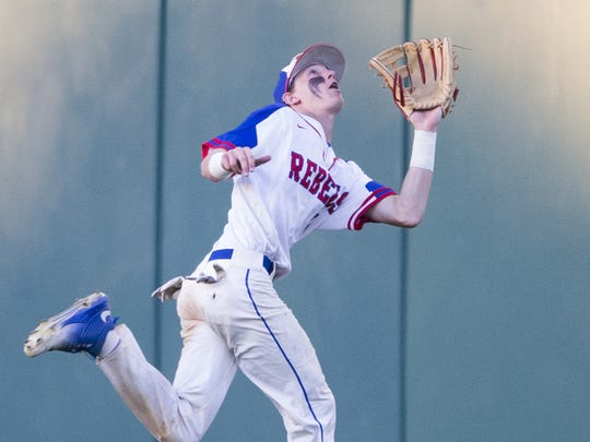 Nick Schnell of Roncalli High School tracks down an out in the outfield, against Zionsville High School, 4A baseball title game at Victory Field, June 17, 2016.