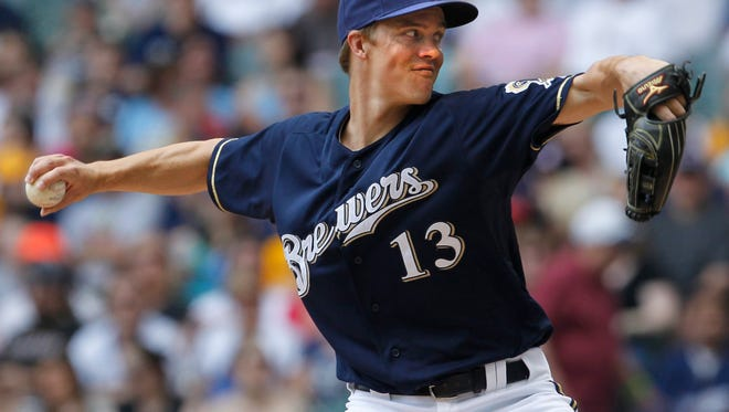 Milwaukee Brewers pitcher Zack Greinke throws against the Minnesota Twins on May 17, 2012.