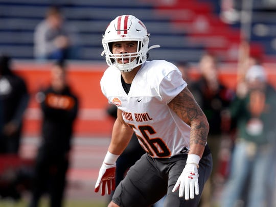 Wisconsin's Zack Baun lines up as the North squad runs drills during practice for the Senior Bowl Wednesday, Jan. 22, 2020, in Mobile, Ala. (AP Photo/Butch Dill)
