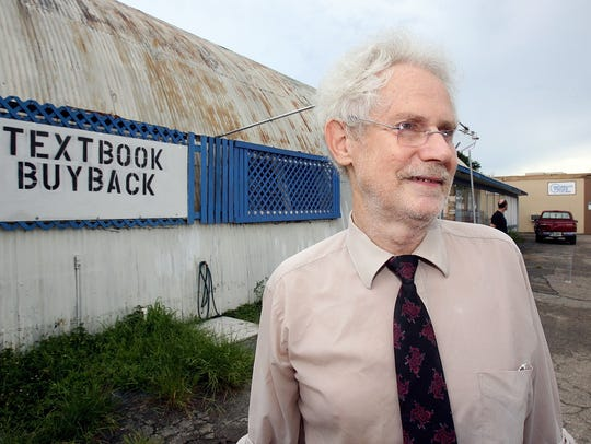 In this August 20, 2010 file photo, Jayson Hays stands outside the International Book Mine and Textbook Warehouse on Gaines Street in Tallahassee.
