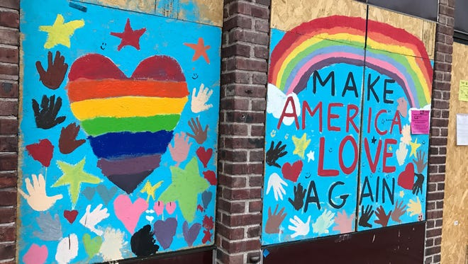 A mural at Power Stretch Studios, 255 Bellevue Ave., was painted over again after it was defaced with pro-Donald Trump graffiti.