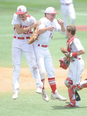 Albany's Ryan Hill, left, and Josh Dyer, center, celebrate the Lions' 12-5 victory over Stinnett West Texas on Friday, June 2, 2017 in Lubbock. The victory gave the Lions a sweep of the Region I-2A final series, sending them to the  state tournament for the first time in program history.