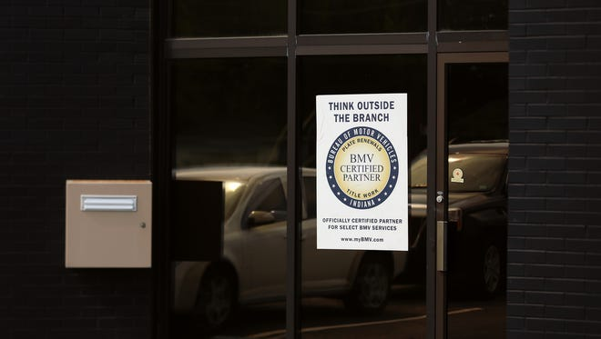 Express Motor Vehicle Administration on the east side offers vehicle title and registration services, Thursday, July 16, 2015, Indianapolis, Ind.