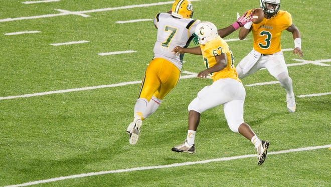 Carver linebacker Lyndell Wilson (3) avoids a tackle attempt by Jefferson Davis' Alec Jackson (7) during the AHSAA football game on Thursday, Oct. 29, 2015, at the Cramton Bowl in Montgomery, Ala.