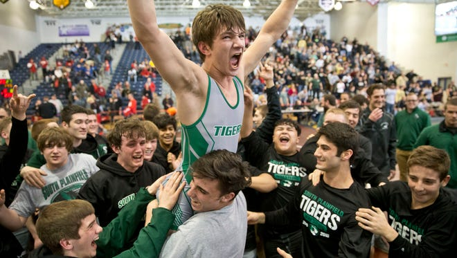 South Plainfield lifts Joe Sacco after winning. South Plainfield vs Delsea in NJSIAA Group III team wrestling finals.  Toms River, NJ Sunday, February 14, 2016@dhoodhood