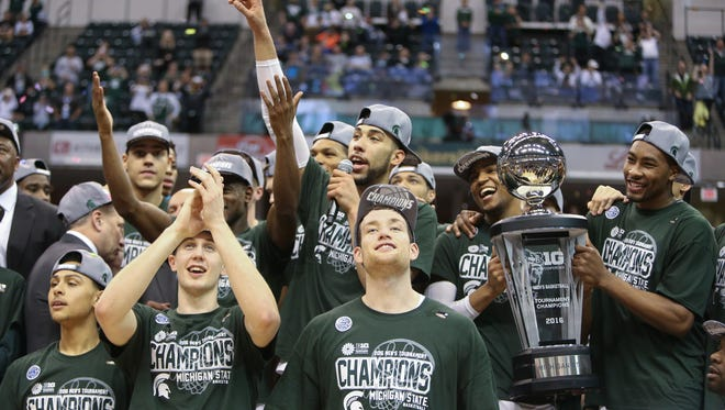 Michigan State raise the Big Ten tournament trophy after beating Purdue, 66-62, on Sunday.