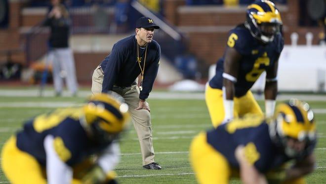 Michigan coach Jim Harbaugh watches the second half of U-M's spring game Friday at Michigan Stadium.