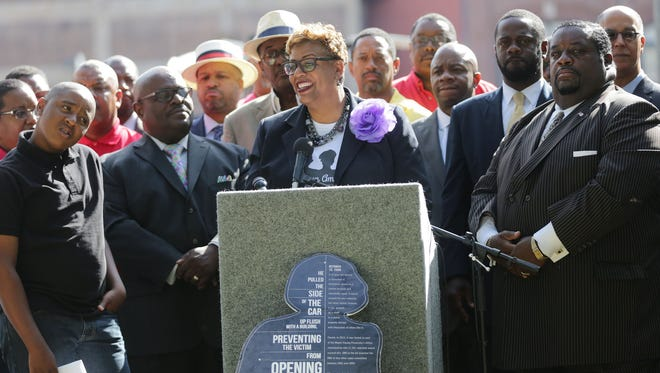 Kim Trent, president of the African American 490 Challenge, stands with Detroit African-American men at Harmonie Park in Detroit ib Tuesday, June 28, 2016.