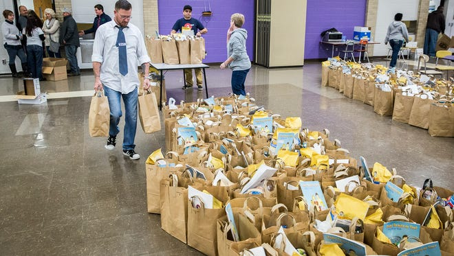 Hundreds of guests were served lunch and 819 meals were delivered to families in need during a past Thanksgiving Feed My Sheep event in Central's cafeteria