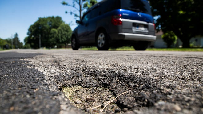 Large potholes mar Riverside Avenue near Ball State Friday afternoon.