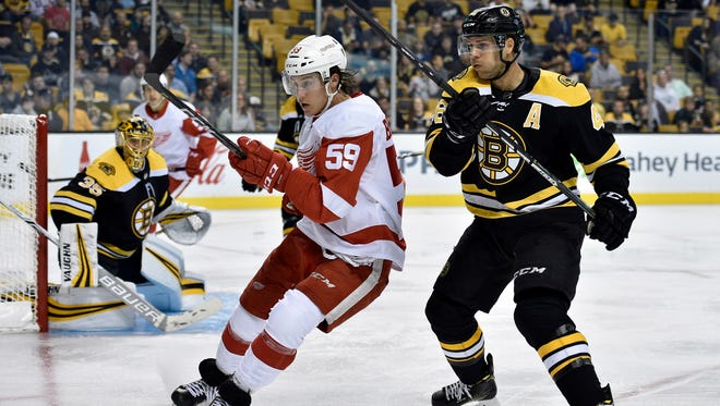 Red Wings left wing Tyler Bertuzzi battles and Bruins center David Krejci for the puck during a preseason game on Sept. 19.
