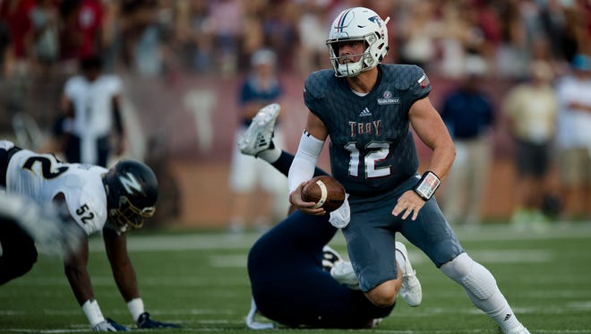Troy quarterback Brandon Silvers (12) runs downfield during NCAA football game between Troy and Akron on Saturday, Sept. 23, 2017, in Troy, Ala.
