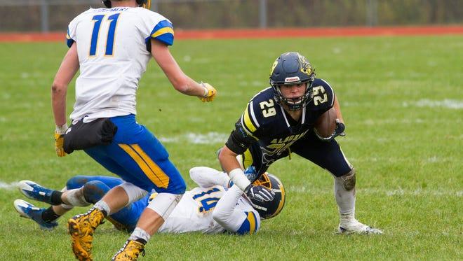 Ida's Zach Stein pulls Algonac's Luke Stephenson down during the MHSAA division 5 championship football game at Algonac High School Nov. 4.