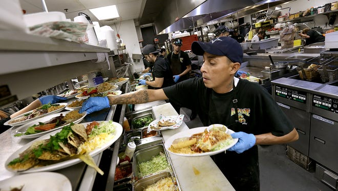 L&J Cafe cook Steve Sanchez works in the kitchen on a busy Thursday. L&J Cafe was named Best Tex-Mex in the state of Texas in a USA TODAY reader's choice contest.