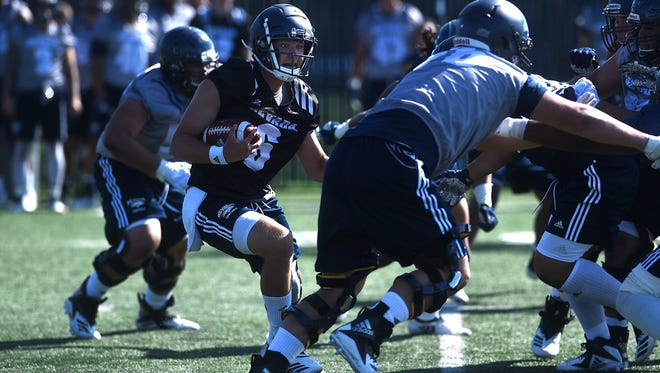 Nevada quarterback Ty Gangi runs during practice on Thursday.