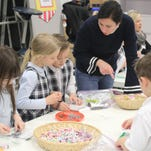 All Saints students learn about cash at Money Carnival