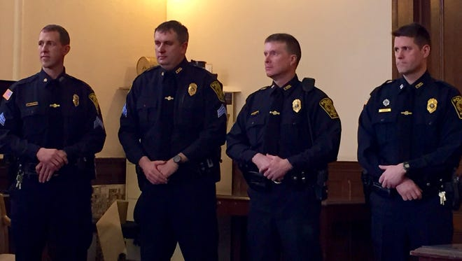 Four Elmira police officers received promotions during a small ceremony held Thursday afternoon at City Hall. They are, from left, Bill Solt and Zachary Stewart, both promoted to sergeant, Tim Dacey, promoted to lieutenant, and Eugene Walrath, promoted to captain.
