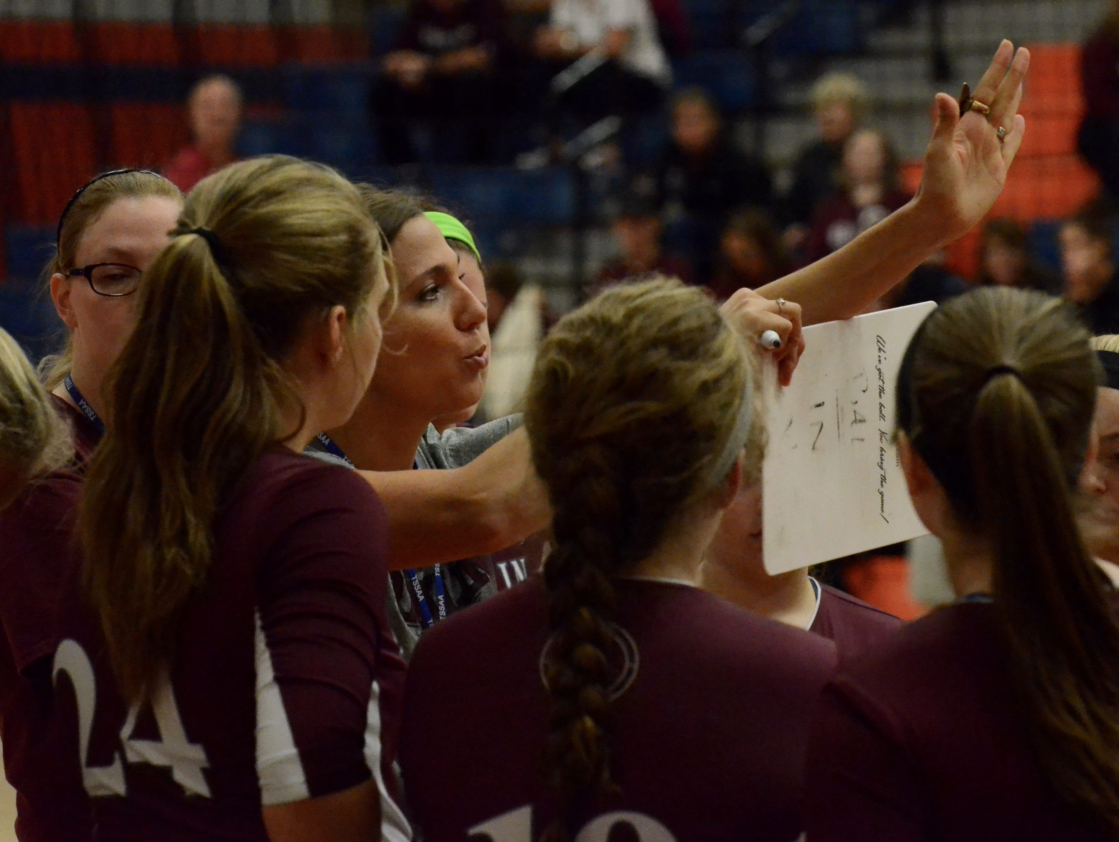 Franklin coach Amber Holzer talks to her team during Thursday's Class AAA elimination match against Farragut at Blackman High School