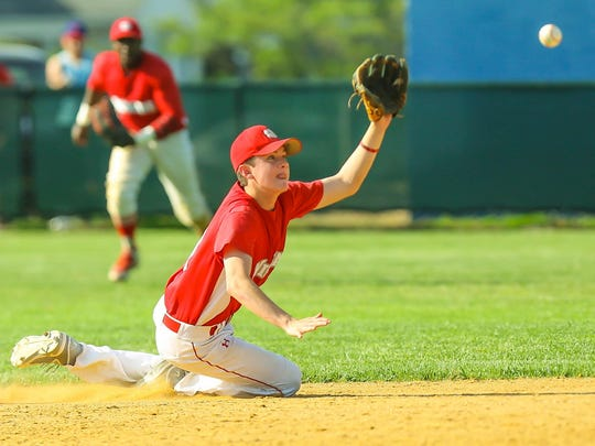 St. Joseph's John Payne makes a sliding catch during a 7-5 triumph over Ranney on May 26.