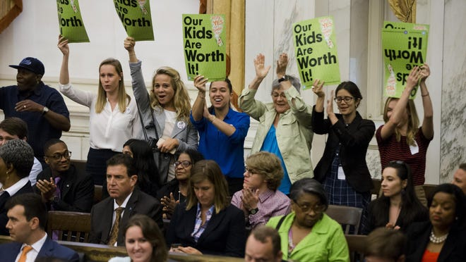 Audience members cheer after Philadelphia City Council passed a tax on sugary and diet beverages, in Philadelphia, Thursday, June 16, 2016. Philadelphia has become the first major American city with a soda tax despite a multimillion-dollar campaign by the beverage industry to block it. (AP Photo/Matt Rourke)