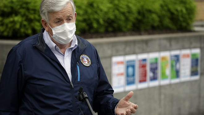 Gov. Mike Parson talks to the media outside Ford's Kansas City Assembly Plant May 15 in Claycomo after touring the plant to see new safety measures put in place to help prevent the spread of coronavirus. Parson will announce the next steps in easing restrictions on public gatherings on Thursday.