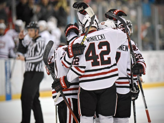 St. Cloud State players celebrate a goal during the