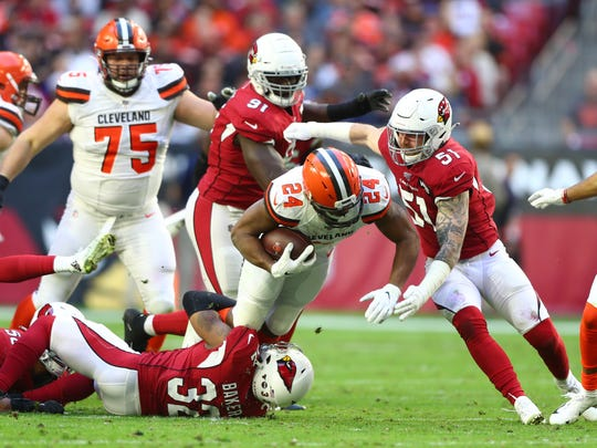 Dec 15, 2019; Glendale, AZ, USA; Cleveland Browns running back Nick Chubb (24) is tackled by Arizona Cardinals linebacker Tanner Vallejo (51) and safety Budda Baker (32) in the first half at State Farm Stadium. Mandatory Credit: Mark J. Rebilas-USA TODAY Sports