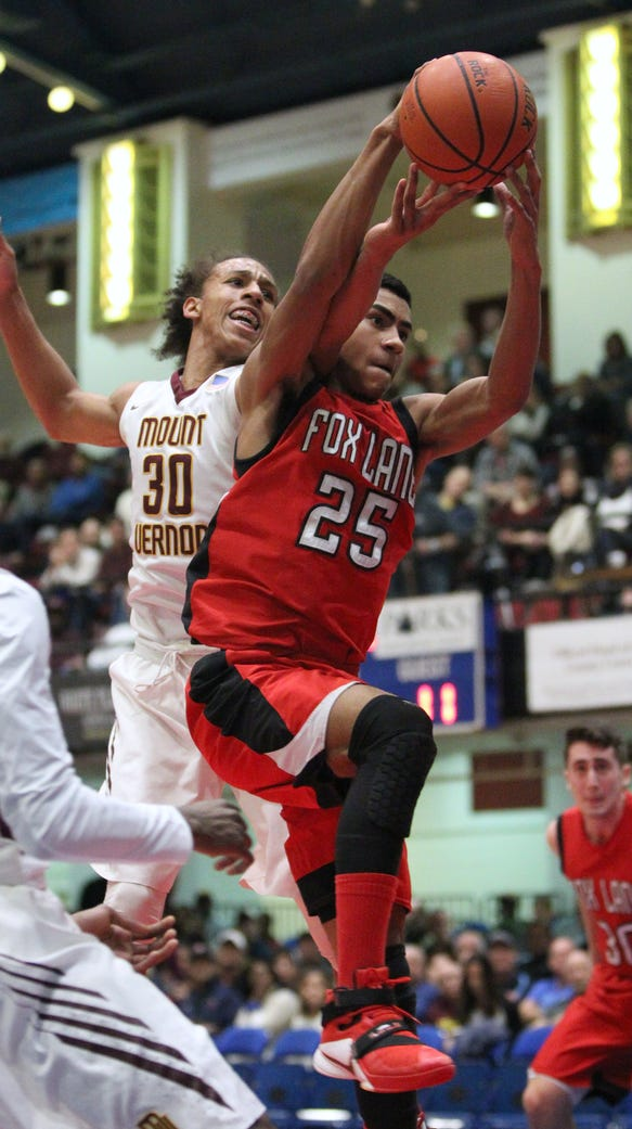 Mount Vernon's Noah Morgan fights for a rebound by