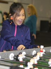 Ella Yang of Manitowoc tries out the foosball game