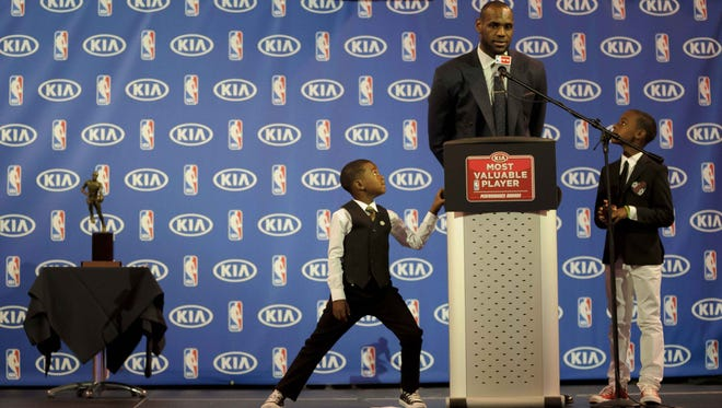 LeBron James is close with his sons, LeBron Jr. (right) and Bryce (left).