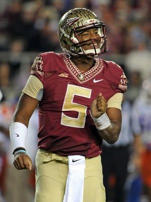 Florida State Seminoles quarterback Jameis Winston (5) smiles during the game against the Florida Gators at Doak Campbell Stadium.