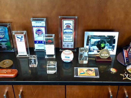 Tickets stubs, baseball cards and other memorabilia in Vanderbilt baseball coach Tim Corbin's office.