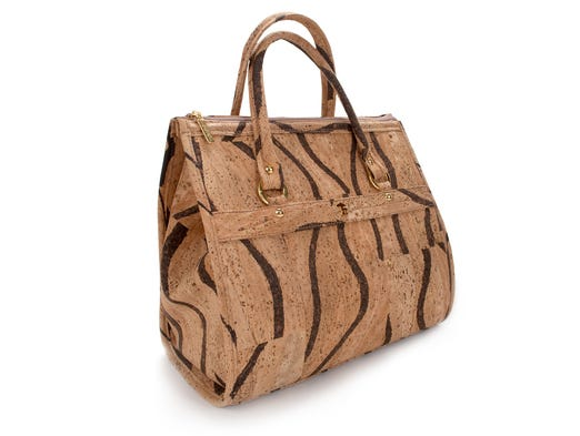 This image released by ShopCorkDesign.com shows the Okapi handbag made of cork fabric in Portugal. Cork. It's not just for wine stoppers and bulletin boards anymore. Embraced by some progressive furniture makers decades ago and a staple in housewares, cork has found a larger place among shoes, handbags, jewelry and other fashion accessories. (AP Photo/ShopCorkDesign.com)