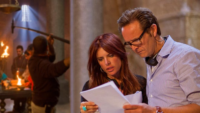 Husband-and-wife team and co-producers Roma Downey and Mark Burnett consult on the set of their motion picture 'Son of God.'