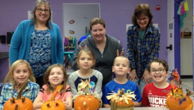 During the November meeting of the Peas-in-a-Pod junior gardeners, the group found a way to lengthen the season for enjoying pumpkins. From left, front are Addie Weber, Madelyn Weiler, Lily Laipply, Logan Laipply and Tyler Rexroad; and back, Amy Frizzell, Sarah Laipply and Janet Nance, all are members of Earth, Wind and Flowers Garden Club.