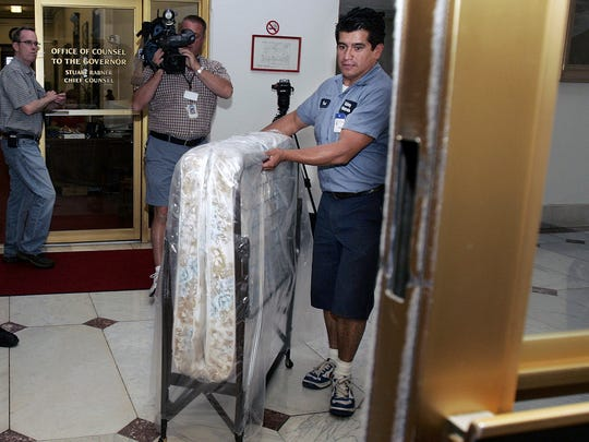 Paul Duenas delivers a cot to the governor's office