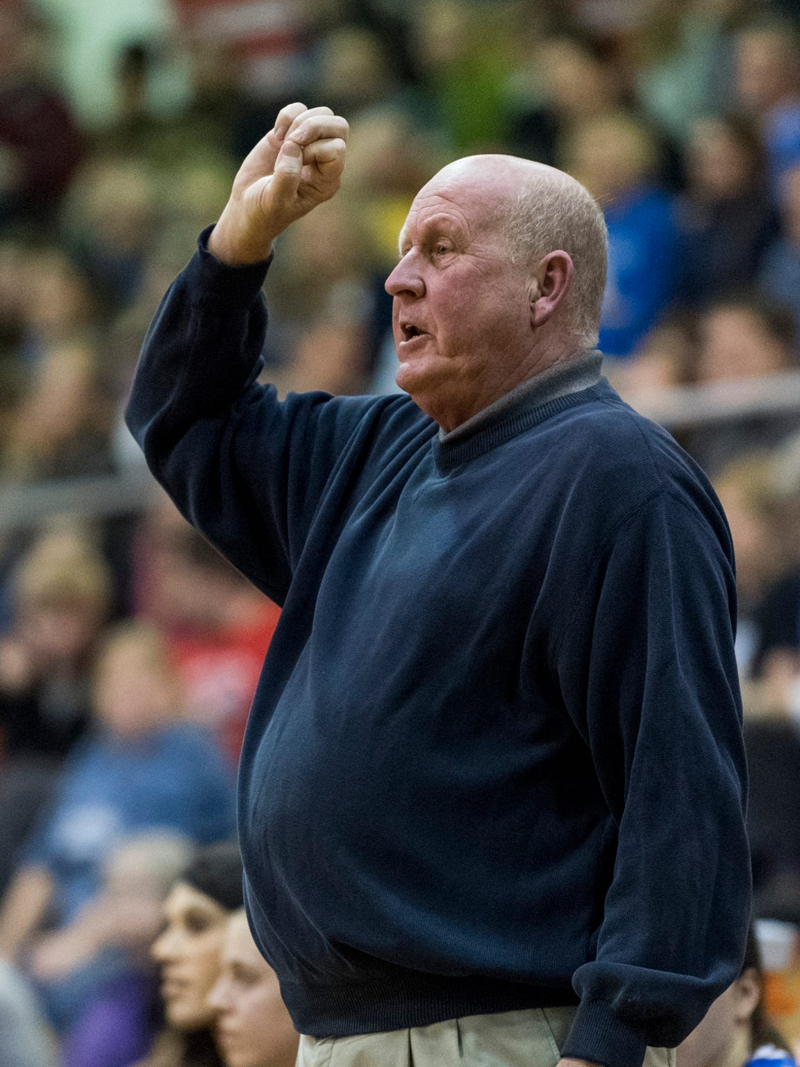 Memorial Head Coach Bruce Dockery calls out a defensive play as his team takes on the Castle Knights during the SIAC Tournament Championship match at Harrison High School in Evansville, Ind., Saturday, Jan. 20, 2018.