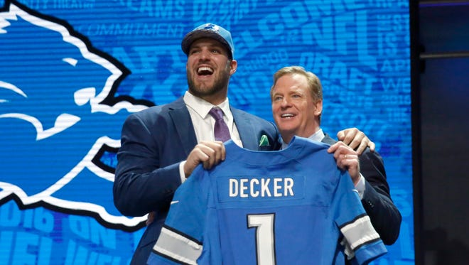 Ohio State''s Taylor Decker poses for photos with NFL commissioner Roger Goodell after being selected by the Detroit Lions as the 16th pick in the first round of the 2016 NFL football draft, Thursday, April 28, 2016, in Chicago. (AP Photo/Charles Rex Arbogast)