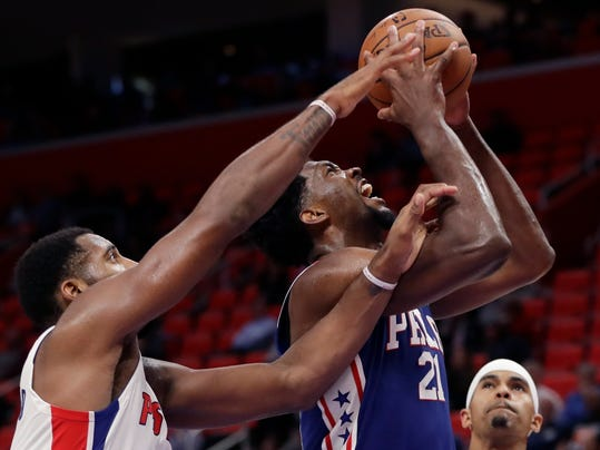 Philadelphia 76ers center Joel Embiid (21) shoots as Detroit Pistons center Andre Drummond (0) reaches in during the second half of an NBA basketball game against the Detroit Pistons, Monday, Oct. 23, 2017, in Detroit. (AP Photo/Carlos Osorio)