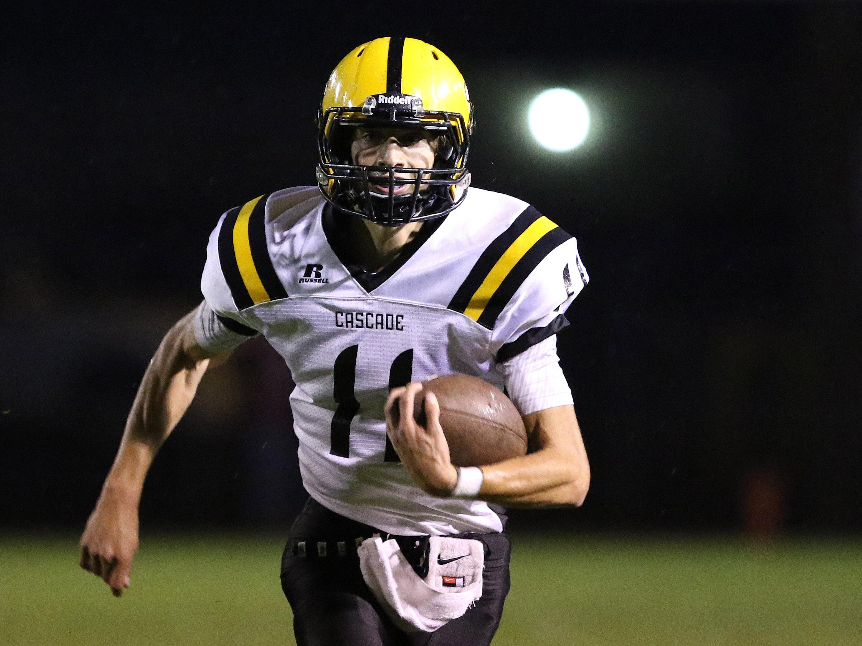 Cascade quarterback John Schirmer rushed for 31 yards and a touchdown against Stayton.